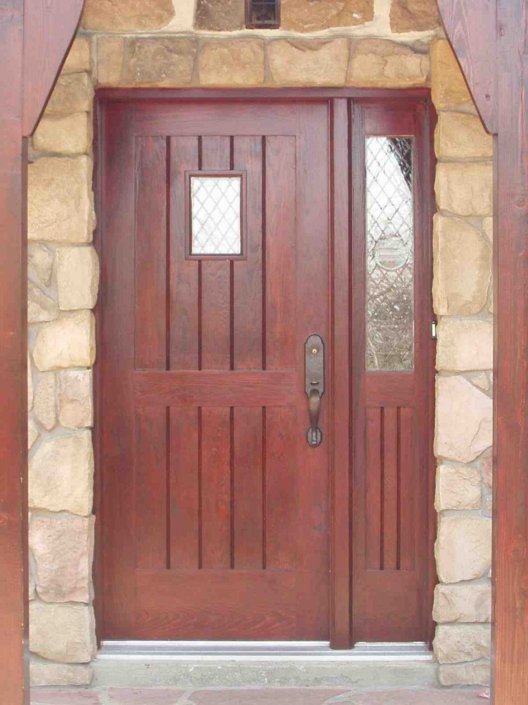 Wood doors custom entrance wood doors installation in for Wood entry doors